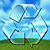 Icon of recycle logo on top of green land and blue sky